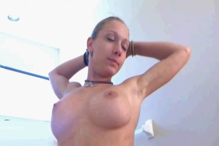 Naked girl brushing her teeth - beautiful breasts