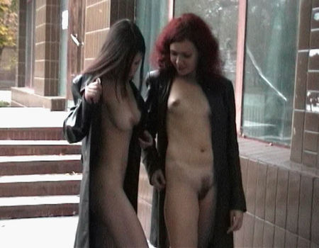 Two girls show their bodies on the street
