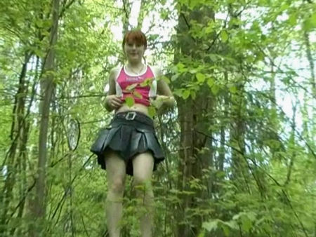 very young girl pissing in the forest - urine video