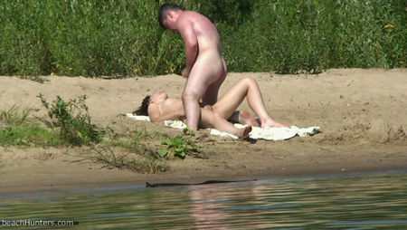 Cute couple having sex on the riverbank